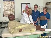 Cute Doctors Examine Black Patient 1