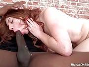 Redhead Hottie Swallows Large Black Dick 1
